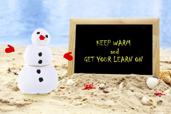 Christmas snowman on beach with photoframe. Christmas and New Ye